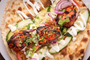 Chicken Tikka in fresh Naan